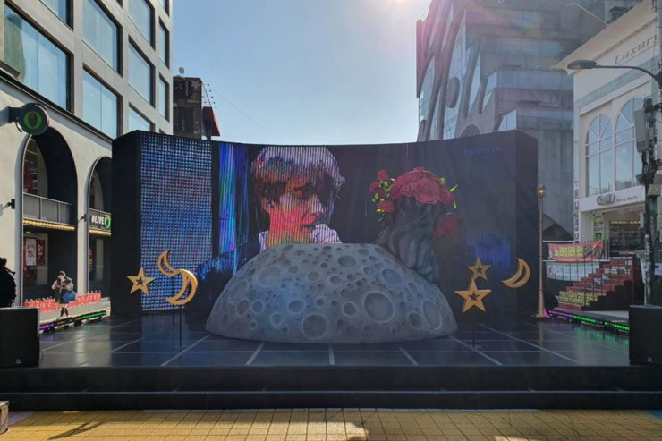 A giant street sculpture with a LED screen showing BTS member Jin was built by his Chinese fan club 'China Jin Bar' at Hongdae entertainment area in Seoul's Mapo District on Tuesday. Courtesy of Mapo District Office