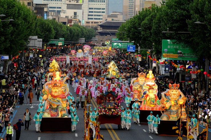 A baby Buddha statue and lanterns of the four heavenly guardians of Buddhism lead a Yeondeunghoe, or Lotus Lantern Festival parade in 2018. Courtesy of Cultural Heritage Administration