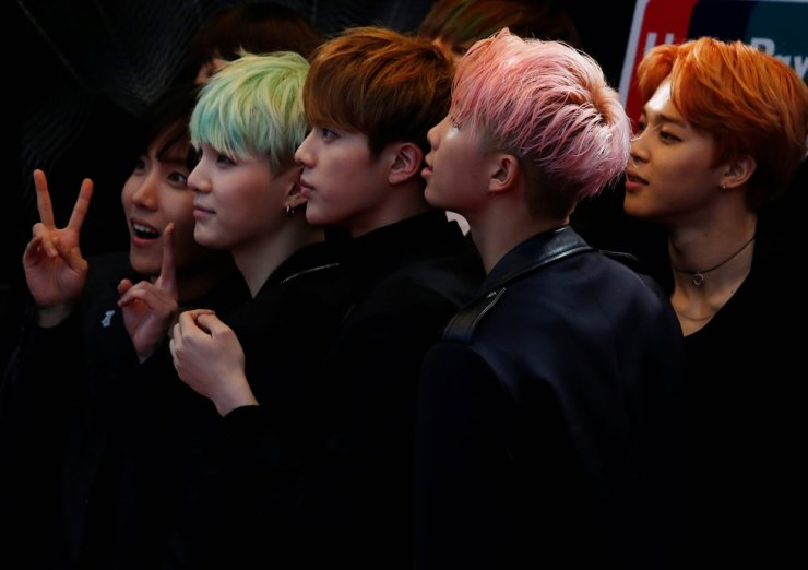 Members of K-Pop band BTS react on the red carpet during 2015 Mnet Asian Music Awards in Hong Kong, in this Dec. 2, 2015, file photo. Reuters