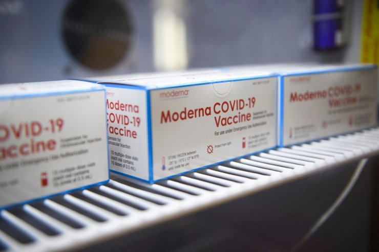 Boxes containing vials of the Moderna COVID-19 vaccine are stored at the Kedren Community Health Center on Jan. 25, 2021, in Los Angeles, Calif. AFP