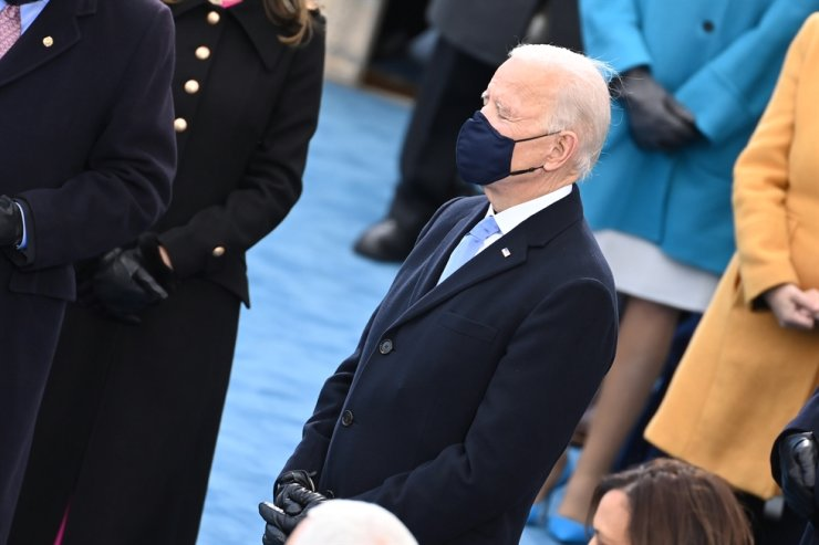 U.S. President-elect Joe Biden prays before being sworn into office during his inauguration ceremony in Washington, D.C., on Jan. 20. EPA-Yonhap