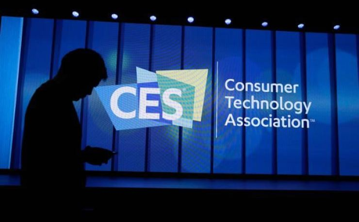 An attendee passes by the stage during the Consumer Electronics Show (CES) 2020 at the Mandalay Bay Convention Center in Las Vegas in this January 2020 file photo. / AP-Yonhap