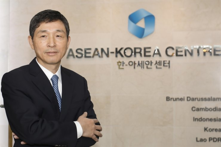 ASEAN-Korea Centre Secretary General Lee Hyuk poses at the entrance of the center in downtown Seoul. / Courtesy of ASEAN-Korea Centre