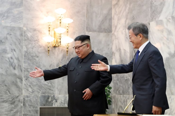 President Moon Jae-in and North Korean leader Kim Jong-un greet each other at the northern side of Panmunjeom in May 2018, a few weeks ahead of the U.S.-North Korea summit in Singapore in June. Courtesy of Cheong Wa Dae
