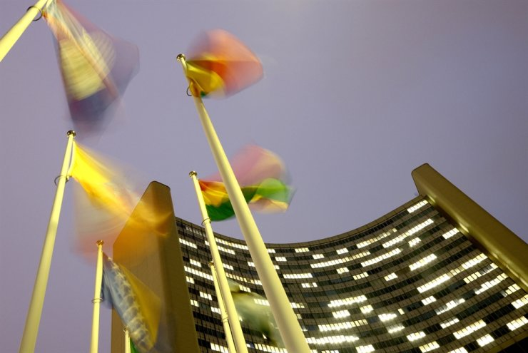 Flags flutter in the wind in front of the headquarters of the International Atomic Energy Agency (IAEA) in Vienna, Austria, December 16, 2020. / REUTERS-Yonhap