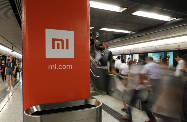 In this July 9, 2018, file photo, an advertisement for Xiaomi is displayed at a subway station in Hong Kong. AP
