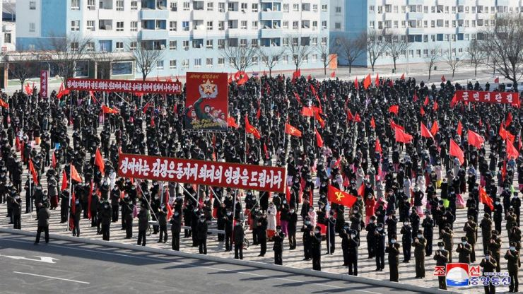This photo released by North Korea's Korean Central News Agency, Wednesday, shows a joint army-civilian rally held the previous day. It reported the events were held in four provinces to show determination to thoroughly implement the decisions made at the recent 8th Congress of the ruling Workers' Party. Yonhap