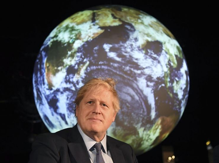 Britain's Prime Minister Boris Johnson launches the upcoming UK-hosted COP26 UN Climate Summit in London, England. The British leader has invited President Moon Jae-in to the upcoming G-7 meeting in June, according to Cheong Wa Dae, Friday. AP-Yonhap