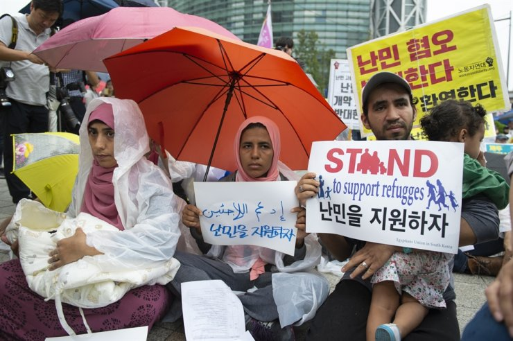 Asylum seekers and refugees participate in a rally held in Seoul's Jongno District and organized by Amnesty International and NANCEN, a refugee rights group based in Eunpyeong District, calling for better treatment and support in this September 2018 photo. / Korea Times photo by Choi Won-suk