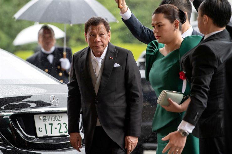 Philippines President Rodrigo Duterte arrives with daughter and first lady Sara Duterte-Carpio to attend the enthronement ceremony of Japan's Emperor Naruhito in Tokyo, Japan, Oct. 22, 2019. Reuters