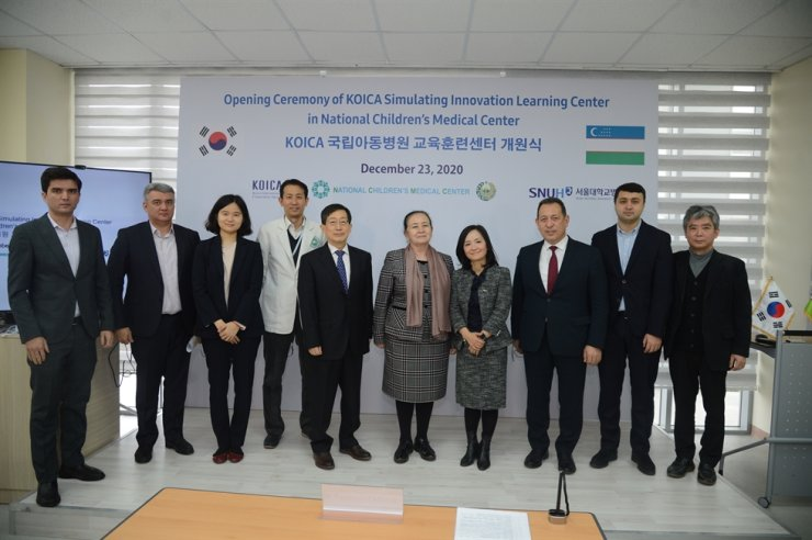 Representatives from Korea International Cooperation Agency (KOICA), Uzbekistan's National Children's Medical Center and other medical institutions of the two countries join the opening ceremony of Simulating Innovation Learning Center in the Uzbek capital city of Tashkent, Dec. 23. / Courtesy of KOICA