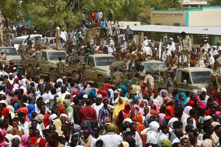 In this file photo taken on April 2, 2016, a convoy of Sudanese security forces are deployed during a rally in al-Geneina, the capital of the West Darfur state. Ongoing clashes in Sudan's restive Darfur have killed at least 83 people. AFP