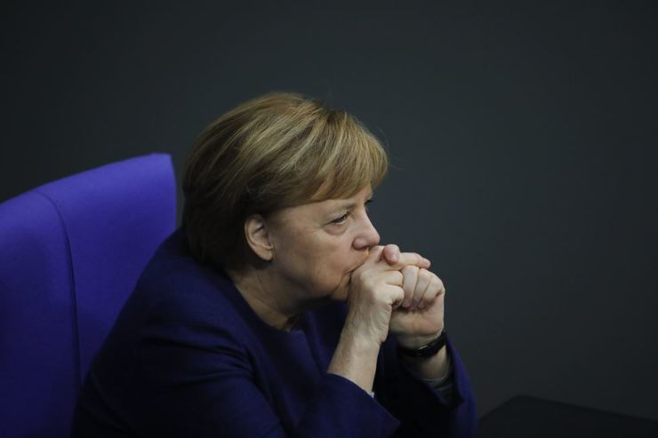 In this Dec. 8 file photo, German Chancellor Angela Merkel attends the debate about Germany's budget 2021, at the parliament Bundestag in Berlin, Germany. / AP-Yonhap