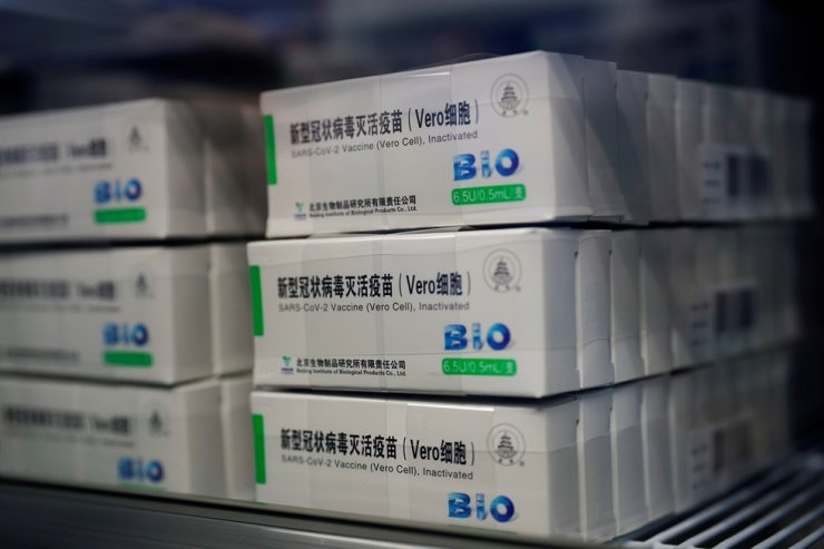 Boxes of Sinopharm's China National Biotec Group vaccine against COVID-19 are pictured at a vaccination site in Shanghai, China, Jan. 19, 2021. Reuters