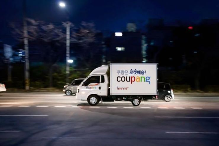 A Coupang vehicle is driven down a road in Seoul in this 2020 file photo. / Courtesy of Coupang