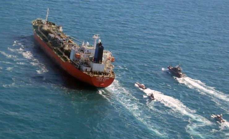 In this Monday, Jan. 4, 2021 file photo released by Tasnim News Agency, a seized South Korean-flagged tanker is escorted by Iranian Revolutionary Guard boats on the Persian Gulf. AP-Yonhap