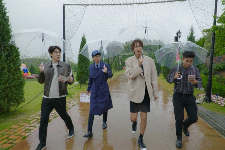From left, EXO Sehun, comedian Yoo Jae-suk, actor Lee Kwang-soo and singer Kim Jong-min are seen in the third season of Netflix's 'Busted' / Courtesy of Netflix