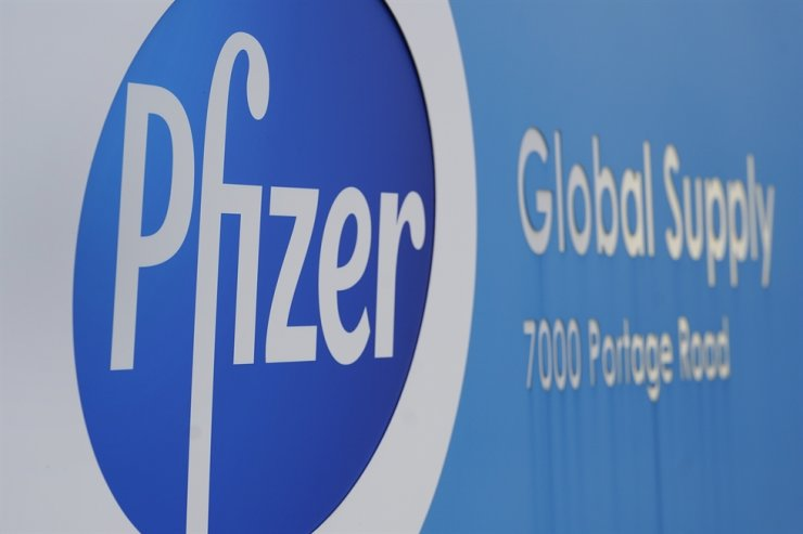In this Friday, Dec. 11, 2020, file photo, a Pfizer Global Supply Kalamazoo manufacturing plant sign is shown in Portage, Mich. New research suggests that Pfizer's COVID-19 vaccine can protect against a mutation found in two contagious variants of the coronavirus that erupted in Britain and South Africa. AP