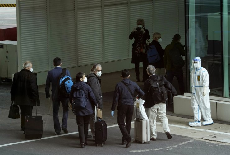 Members of the World Health Organization team arrive at the airport in Wuhan in central China's Hubei province on Thursday, Jan. 14, 2021. AP