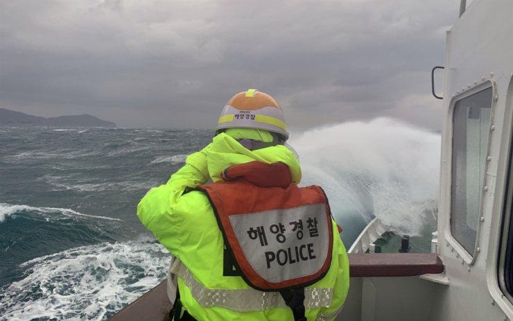 Maritime police search the missing crew members in waters off the southern island of Geoje, Saturday. Courtesy of Coast Guard