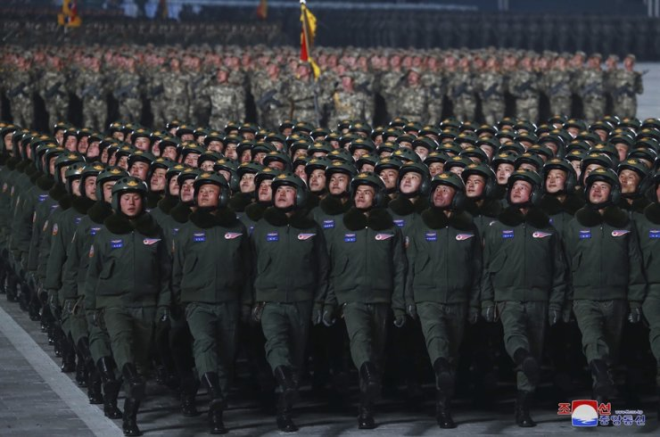 North Korean soldiers march in formation during a military parade marking the Workers' Party Congress, at Kim Il Sung Square in Pyongyang, Jan. 14, in this photo provided by the North Korean government. AP