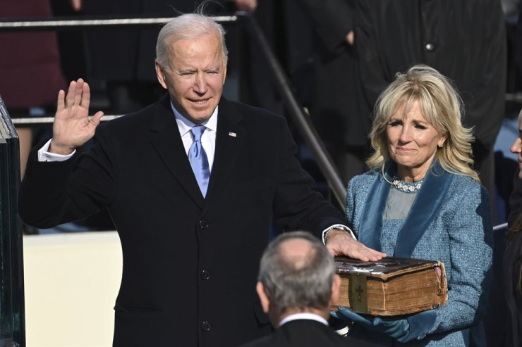 Joe Biden is sworn in as the 46th president of the United States by Chief Justice John Roberts as Jill Biden holds the Bible during the 59th Presidential Inauguration at the U.S. Capitol in Washington, Wednesday, Jan. 20, 2021. AP