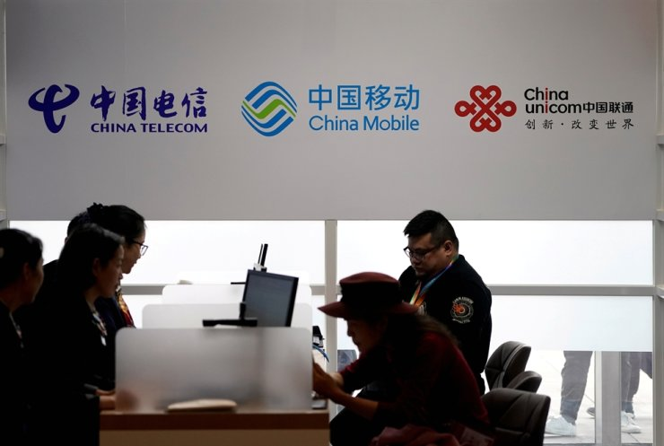 Signs of China Telecom, China Mobile and China Unicom are seen during the China International Import Expo (CIIE) at the National Exhibition and Convention Center in Shanghai, China, Nov. 5, 2018. Reuters