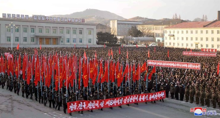 People hold a campaign in Pyongyang, North Korea, to uphold the decisions made at the 8th Congress of the Workers' Party of Korea, Jan. 20. / Yonhap
