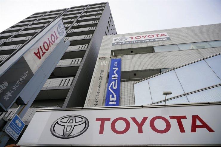 The Toyota Motor logo hangs outside the carmaker's retailer in Tokyo, Feb. 10. EPA-Yonhap