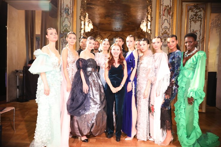 Haute Couture Designer Kay Kim, center, poses with models after holding a fashion show at the Baccarat Museum in Paris in this May 19, 2019 photo. Courtesy of Kay Kim