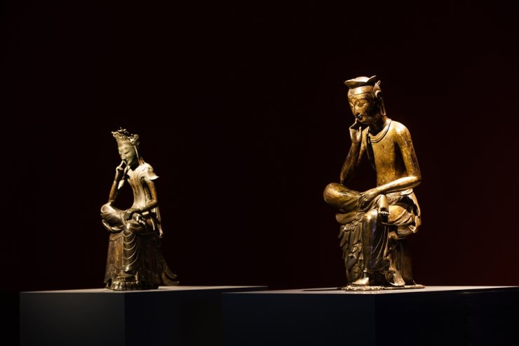 Two 'Pensive Bodhisattva' statues, National Treasure no. 83, right, and National Treasure no. 78, are displayed together during a 2015 Buddhist sculpture exhibition at the National Museum of Korea. The museum will open a new permanent gallery to display the two major artifacts side by side in November. Courtesy of National Museum of Korea