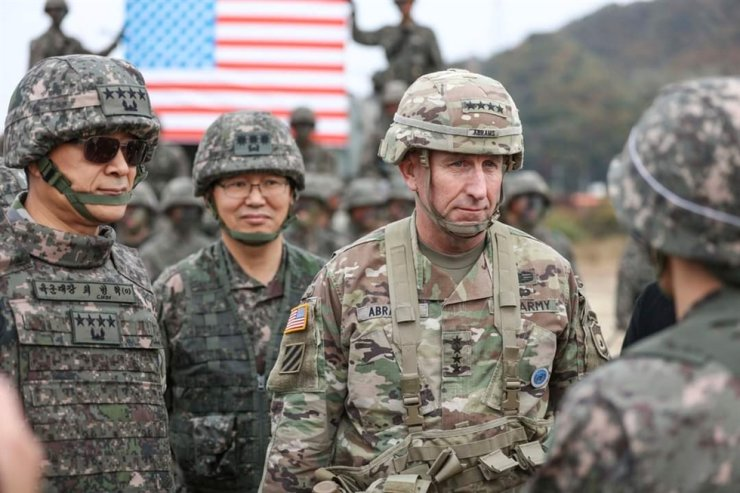 U.S. Forces Korea Commander Gen. Robert Abrams, third from left, inspects a joint military exercise between South Korea and the United States in this October 2019 photo. / Korea Times file