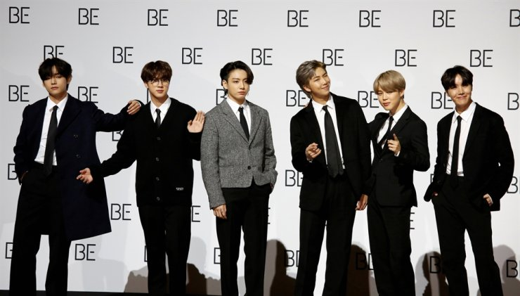 Members of K-pop boy band BTS pose for photographs during a news conference promoting their new album 'BE(Deluxe Edition)' in Seoul, Nov. 20, 2020. Reuters