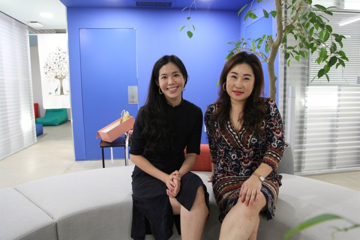 Jo Lam, left, and Somang Yang sit together at their office. / Courtesy of KADA:KUDU