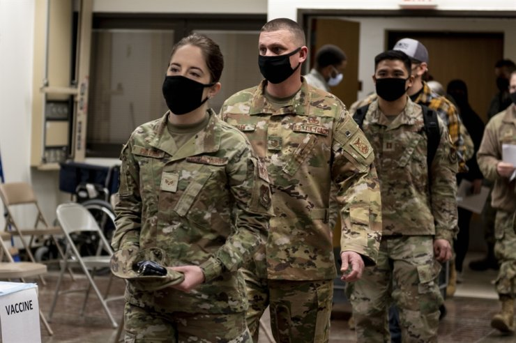 A handout photo made available by the United States Forces Korea shows Members of Team Osan preparing to receive the first round of the Moderna COVID-19 vaccine in December 2020. Yonhap
