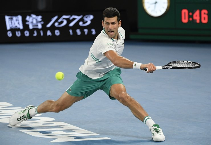 Serbia's Novak Djokovic hits a backhand return to Russia's Daniil Medvedev during the men's singles final at the Australian Open tennis championship in Melbourne, Australia, Sunday. / AP-Yonhap