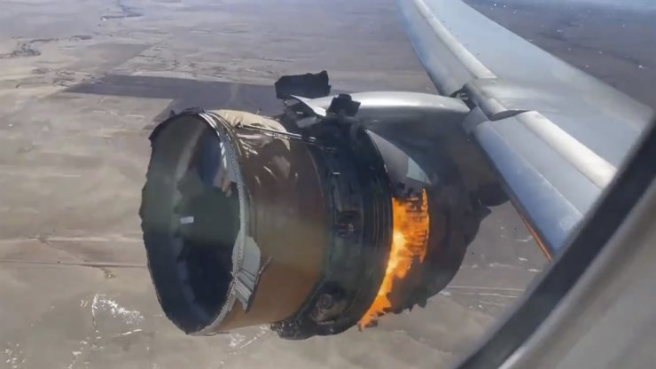 In this image taken from video, the engine of United Airlines Flight 328 is on fire after after experiencing 'a right-engine failure' shortly after takeoff from Denver International Airport, Saturday, Feb. 20, 2021, in Denver, Colo. The Boeing 777 landed safely and none of the passengers or crew onboard were hurt. AP