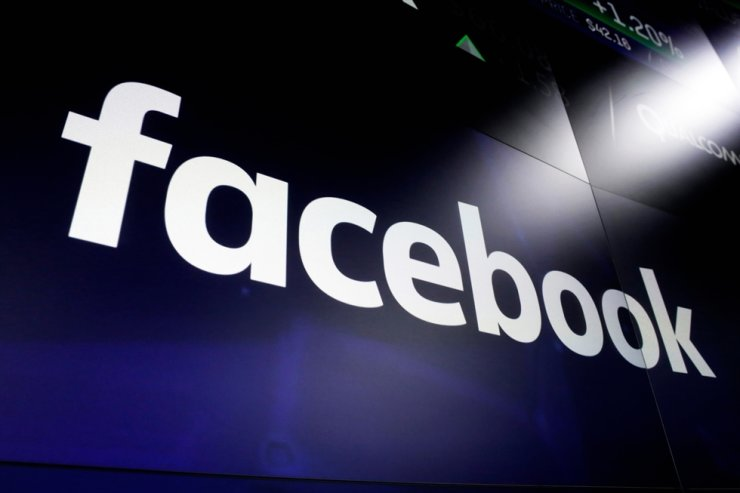 This March 29, 2018, file photo shows the Facebook logo on screens at the Nasdaq MarketSite, in New York's Times Square. AP