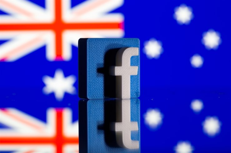 A 3D-printed Facebook logo is seen in front of a displayed Australian flag in this illustration photo taken Feb. 18, 2021. Reuters