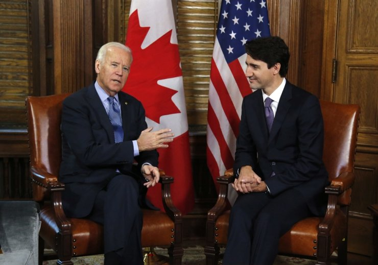 Canadian Prime Minister Justin Trudeau meets with then U.S. Vice President Joe Biden on Parliament Hill in Ottawa in this photo taken on Dec. 9, 2016. Biden will still host Trudeau, Feb. 23 for the first bilateral meeting but will do it virtually. AP