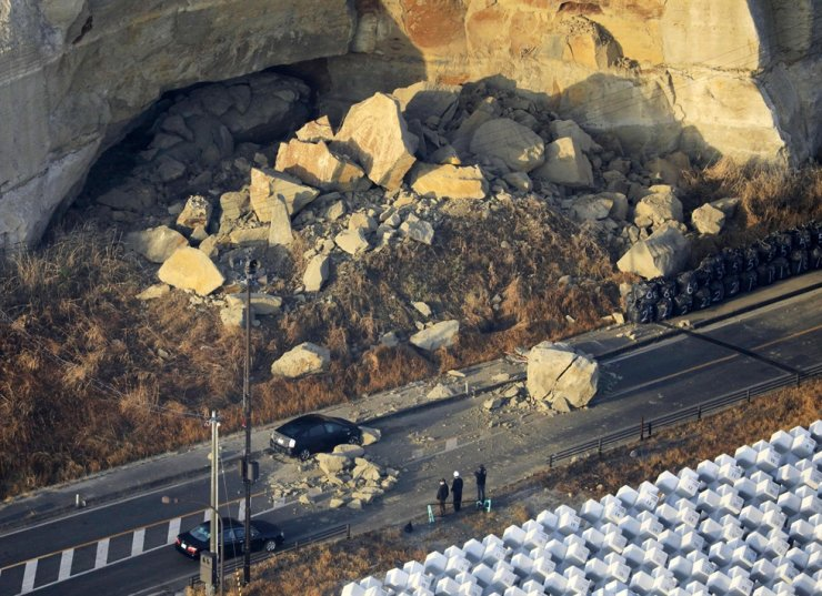 A large boulder sits on a road after an earthquake hit the city, in Soma, Fukushima prefecture, northeastern Japan, Sunday, Feb. 14, 2021. AP