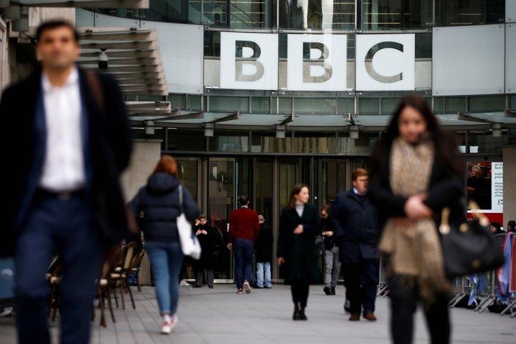 Pedestrians walk past a BBC logo at Broadcasting House in London, Jan. 29, 2020. Reuters