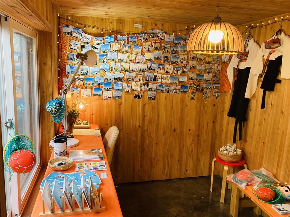 Installation view of the haenyeo exhibition at Little Haenyeo on Jeju Island, featuring Kim Jae-yi's 'Magazine' on the left / Courtesy of Little Haenyeo