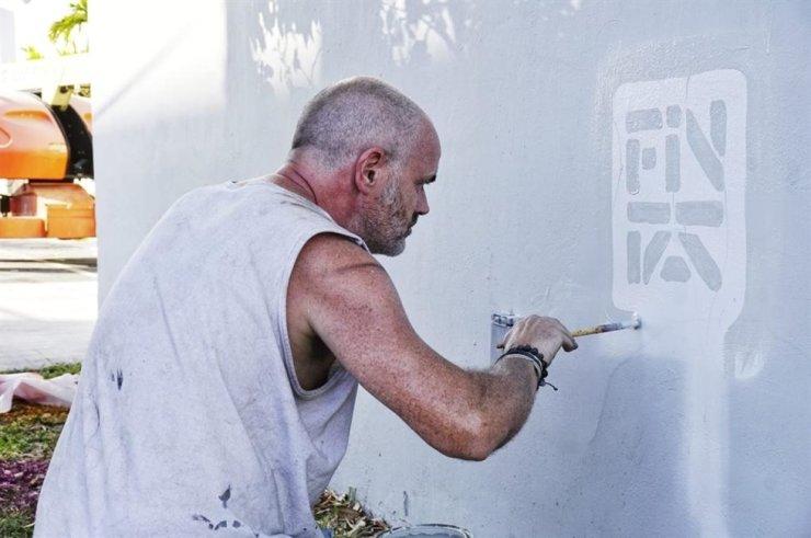 Irish street artist Fin DAC is working on artwork in this undated photo. / Courtesy of Fin DAC