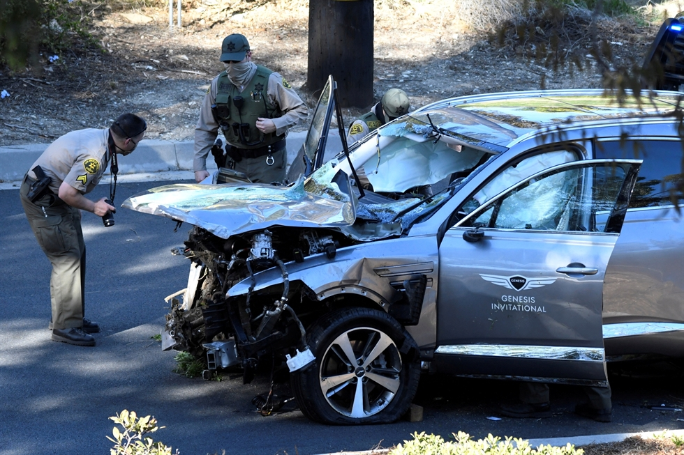 A vehicle rests on its side after a rollover accident involving golfer Tiger Woods Tuesday, Feb. 23, 2021, in Rancho Palos Verdes, Calif. Woods suffered leg injuries in the one-car accident and was undergoing surgery, authorities and his manager said. AP