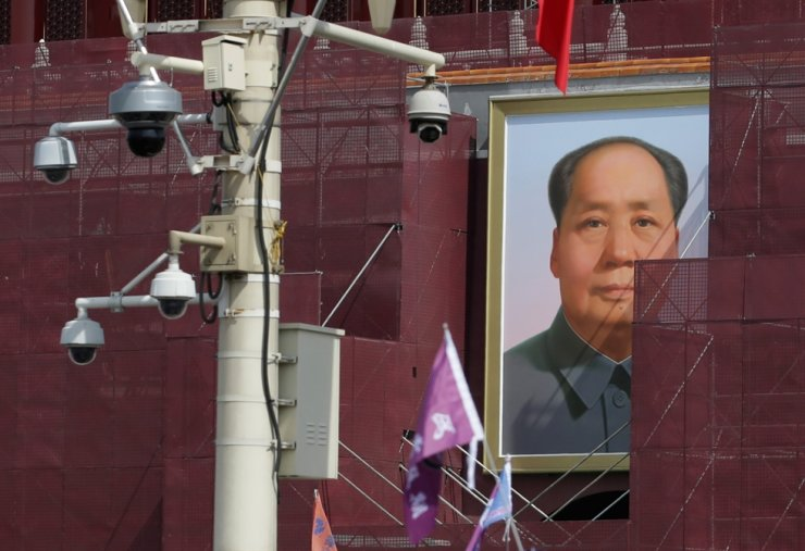 The portrait of late Chinese leader Mao Zedong is seen on Tiananmen Gate, which is covered during renovation works, in Beijing, China, in this May 2019 file photo. Reuters-Yonhap