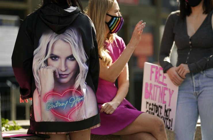 Britney Spears supporters gather outside a court hearing concerning the pop singer's conservatorship at the Stanley Mosk Courthouse, Thursday, Feb. 11, 2021, in Los Angeles. AP