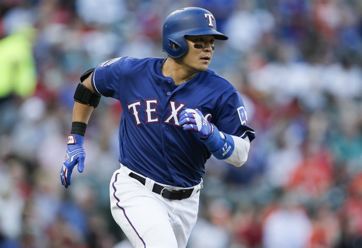 Texas Rangers' Shin-Soo Choo rounds the bases after hitting a solo home run during the first inning of a baseball game against the Houston Astros, Saturday, July 13, 2019, in Arlington, Texas. AP