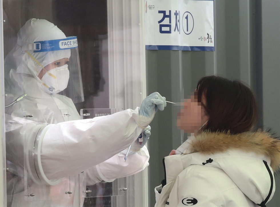 The Korea Disease Control and Prevention Agency's Director Jeong Eun-kyeong speaks during a press conference at the agency's headquarters in Cheongju, North Chungcheong Province, Feb. 15, about the country's inoculation plan for February and March against COVID-19. Yonhap