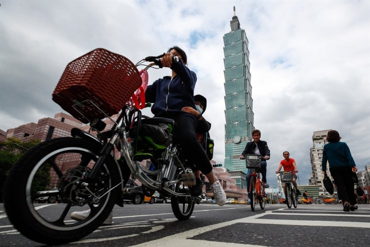 People cross a street in Taipei, Feb. 23, 2021. EPA
